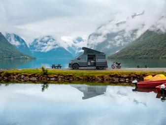Family vacation travel RV, holiday trip in motorhome, Caravan car Vacation. Beautiful Nature Italy natural landscape Alps.